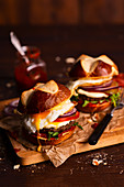 Beef burgers with bavarian roll, egg tomato, red pepper paste and red onions