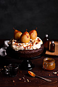 Chocolate cake with pears, whipped cream and caramel