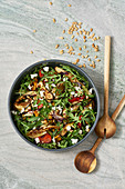 Rocket salad with roasted vegetables, goat's cheese and pine nuts