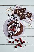 Vegan chocolate cake with cherries and vegan no-bake brownies