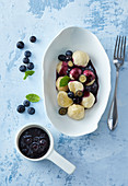 Fermented dumplings with blueberry sauce