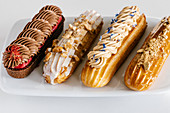 Chocolate, salted caramel, vanilla and earl grey eclairs