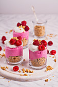 Layered fit dessert with granola, yoghurt and raspberries