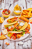 Tacos with halloumi sticks, tomatos, avocado, lettuce and tzatziki sauce