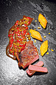 Grilled rump steak with New Orleans jus and polenta slices