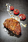 Pork collar steaks with grilled watermelon and goat's cream cheese