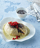 Yeast dumpling with vanilla sauce and poppy seeds