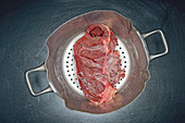 Raw halved veal heart