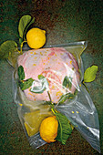 Leg of leg being marinated in Limoncello