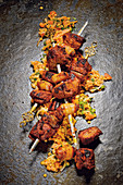 Grilled lamb kebabs with dates wrapped in bacon with a lentil salad