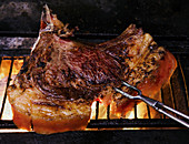 Veal chop on grill