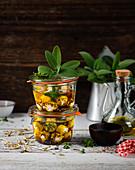 Marinated mozzarella balls in glass jars