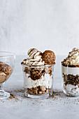 Chocolate and vanilla desserts in glass jars