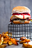 A cheeseburger with plums