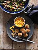 Vegan oat balls with mango salsa