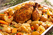 Grilled chicken on a bed of vegetables