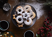 Freshly baked Linzer cookies being dusted with sugar