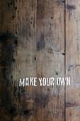 Holzfläche mit Aufschrift 'MAKE YOUR OWN'