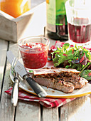 Strawberry pot with horseradish served with steak