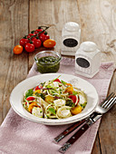 Spaghetti caprese salad with pesto