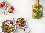 Porridge with quick berry compote, figs and pistachios , Steak, beetroot, horseradish and warm lentil salad, Herby persian frittata