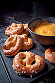 Yeast pretzels with cheese sauce