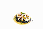 Marinated calamari with black noodles and lime-chili marinade