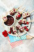 Ice cream crêpe rolls with raspberries and vanilla ice cream