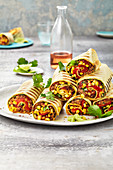 Burritos with minced chilli and a pepper medley