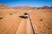 Vehicle crossing desert, Namibia