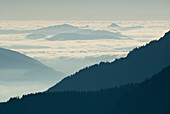 Silhouette of mountainside with clouds