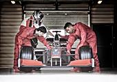 Racing team working in garage