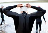 Triathlete adjusting goggles