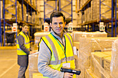 Worker scanning boxes in warehouse
