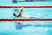 Swimmer racing in pool