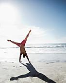 Man in swim trunks on beach