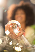 Close up of woman holding crystal ball