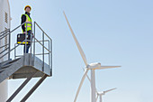 Worker standing on wind turbine