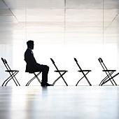 Silhouette of businessman sitting