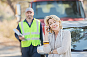 Roadside mechanic behind woman