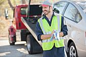 Roadside mechanic wiping hands