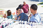 People shopping at yard sale