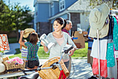 Woman shopping at yard sale