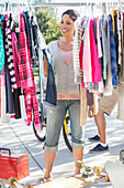 Woman shopping for clothes at garage sale