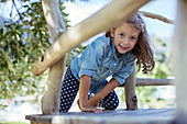 Girl climbing in treehouse outdoors