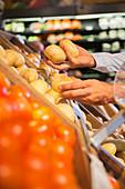 Close up of man selecting produce