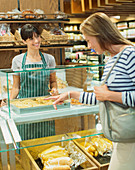 Woman shopping at deli counter