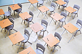 Rows of desks and chairs in classroom