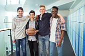 Students holding basketball