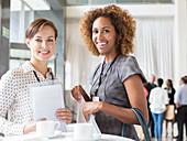 Women standing during coffee break